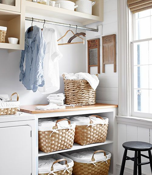 Use baskets to store sorted laundry that's ready to be washed, or washed and folded laundry that's waiting to be put away. Built-in cabinets in the laundry room provide a place to store the baskets so they're not taking up valuable floor space.