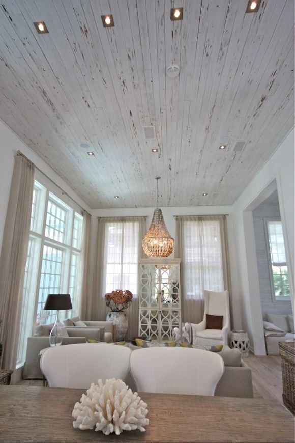 LOVE the distressed white wood ceiling! Rosemary Beach House.