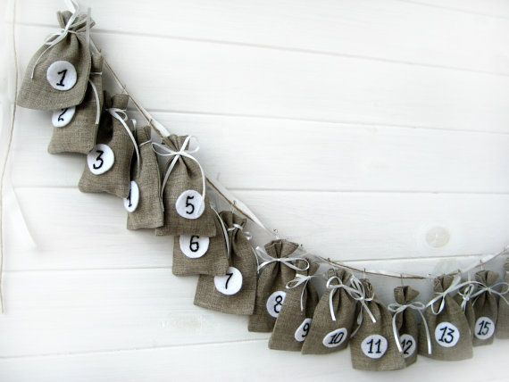 quick to sew - cross stitch, or fabric pen the numbers on felt - we used curtain clips from Ikea to attach to a wide ribbon
