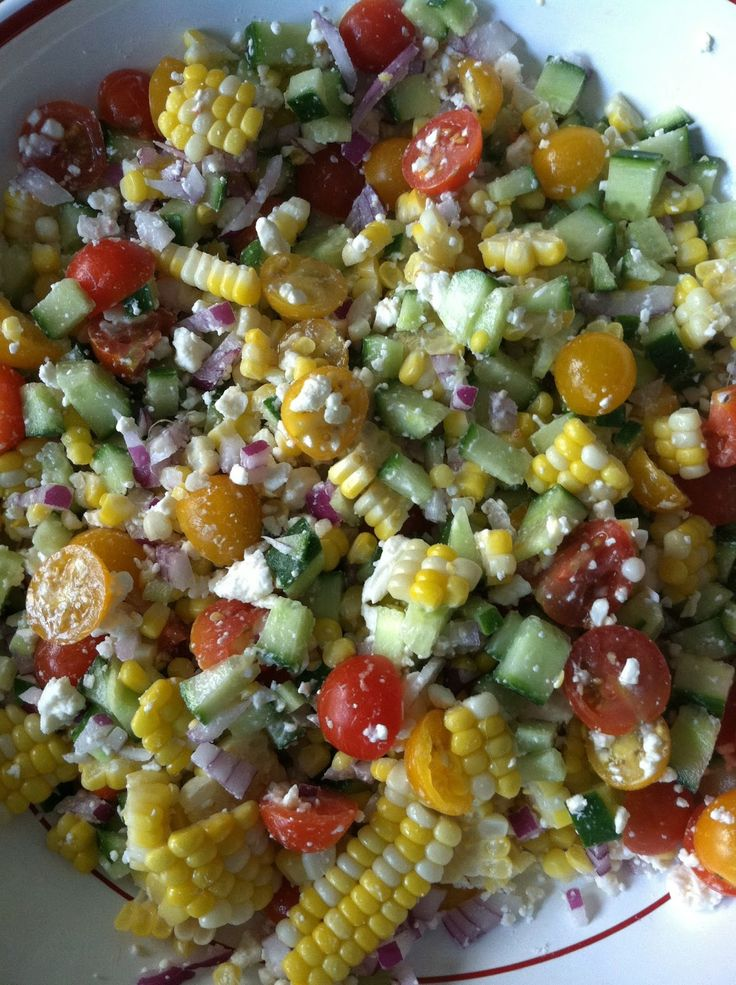 Corn, avocado, tomato, cucumber, and feta salad with cilantro vinaigrette.
