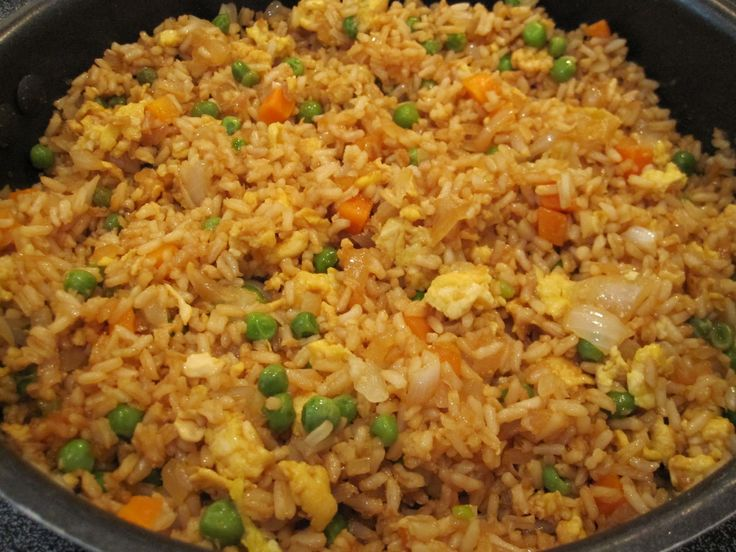 *Fried Rice* 3 cups cooked white rice 3 tbsp sesame oil 1 cup frozen peas & carrots thawed 1 small onion chopped 2 tsp minced garlic 2 eggs slightly beaten 1/4 cup soy sauce On medium high heat, heat oil in wok Add veggie mix, onion, & garlic Stir fry until tender Lower heat to medium low & push mix to one side Pour eggs on other side and scramble Add rice and soy sauce and blend well Stir fry until heated