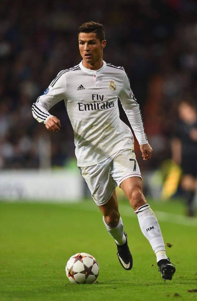 Cristiano Ronaldo of Real Madrid runs with the ball during the UEFA Champions League Group B match between Real Madrid and Liverpool at Estadio Santiago Bernabeu on November 4, 2014 in Madrid, Spain.