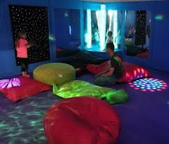 Sensory Room in the Fun Factory Essex. Nice use of beanbags and floor projection.
