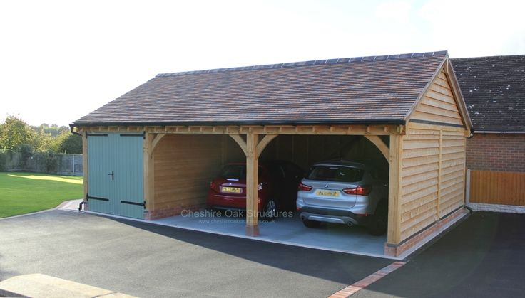 A Bespoke 3 Bay Oak Frame Garage With Painted Softwood