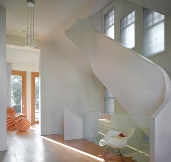 Curvaceous spiral staircase inside a period home.