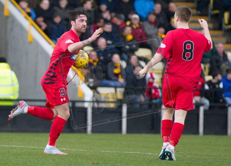 Queen's Park's Chris Duggan acknowledges the congratulations from Jamie McKernon after scoring during the SPFL League Two game between East Fife and Queen's Park.