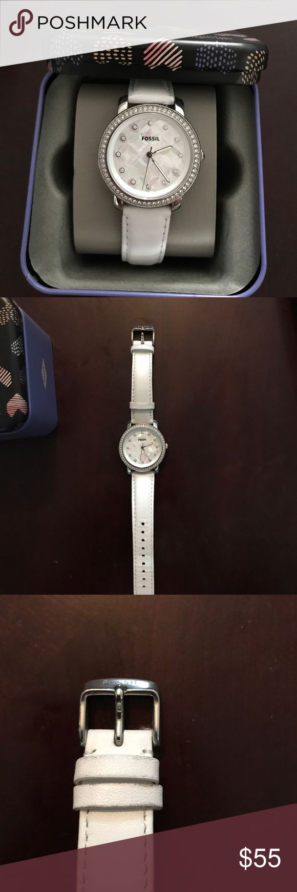 Women's Fossil Watch Fossil Emma Mother of Pearl Dial Watch with White leather band.  Preowned,functioning with new Watch battery and in great condition. Fossil watch box included in price. Fossil Jewelry
