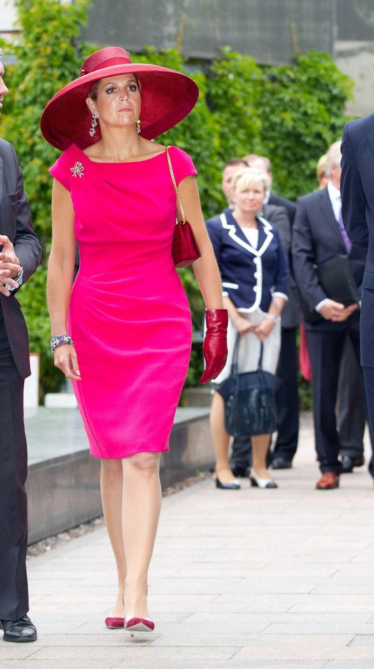 Queen Maxima stuck to her favourite designer Natan during the day and reused a beautiful wide brimmed Fabienne Delvigne hat as well.