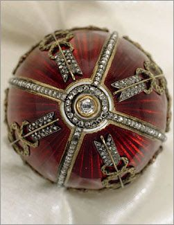 The Imperial Rosebud Egg - Fabergé, 1895; of red enamel, the egg is decorated with rows of diamonds, garlands of gold laurel and Cupid's arrows; On top sits a miniature of Nicholas II, in the base, the year of creation is set underneath a diamond.