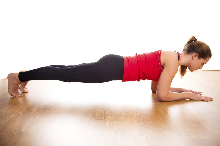 Pressing through an elbow plank with palms facing down will help keep back muscl
