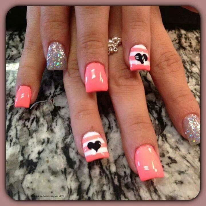 Coral pink and white nails black heart