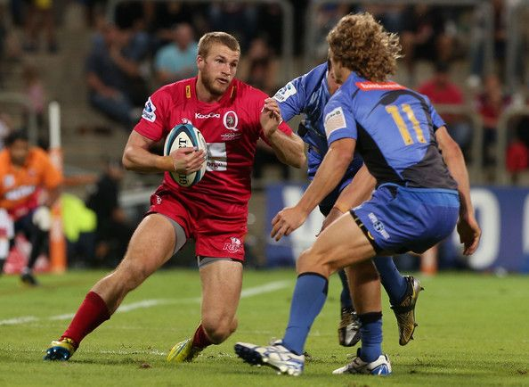 Dom Shipperly of the Reds looks to avoid being tackled by Nick Cummins of the Force during the round 12 Super Rugby match between the Force and the Reds at nib Stadium on May 4, 2013 in Perth, Australia.