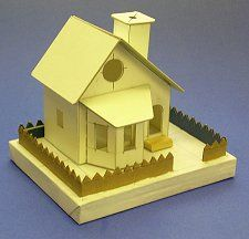 "downloadable pdf template for a cardboard ""putz"" house. Great for an adult to build and a kid to decorate!"