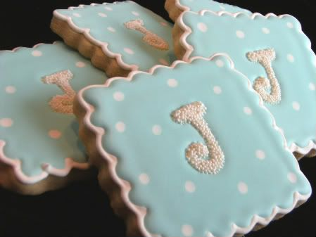 Baby boy monogrammed cookies.  Gently place the pre-made monograms onto the wet icing.