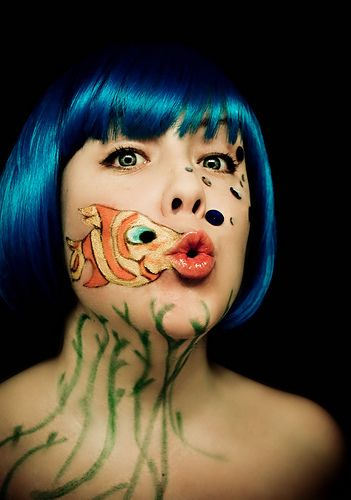 Mermaid with fish mouth.