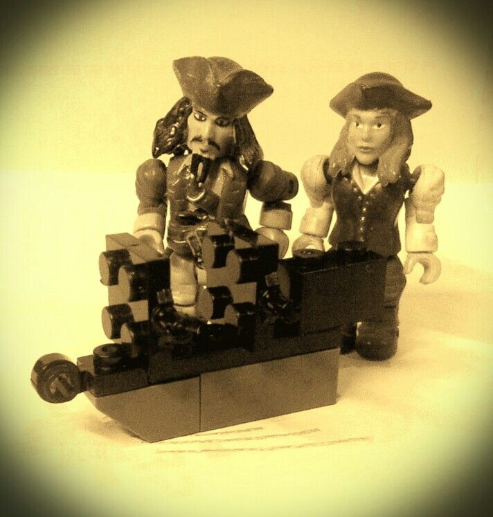 Simple pirate ship. The idea from one of the pic in internet. I just try to build it. Taking a picture with my Jack n Liz megablock.