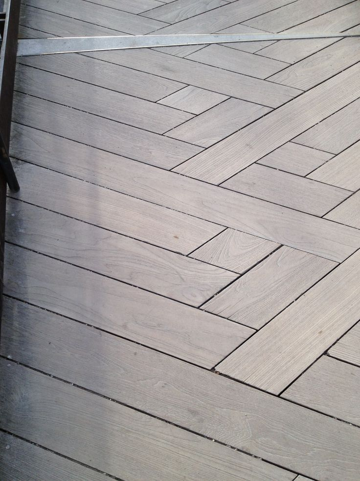 Stamped concrete with faux wood grain, herringbone pattern. The Getty, Los Angeles