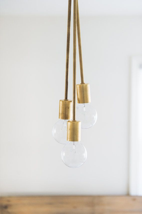 Three different length hanging brass rods meet up to give a fun bubble light to spruce up any room. Black cloth wire can be replaced with many other