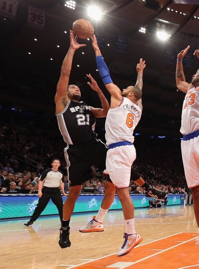 Tyson Chandler #6 of the New York Knicks blocks a shot by Tim Duncan #21 of the San Antonio Spurs