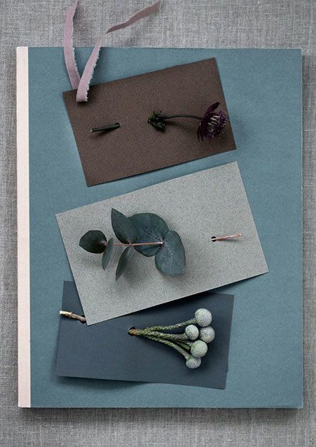 Pretty homemade Christmas cards with small decorative flowers and plants.