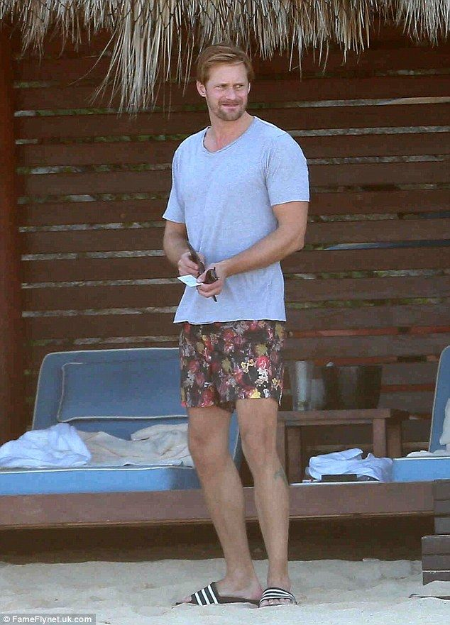 Laid-back look:The True Blood actor styled his casual piece with floral-print shorts, dis...