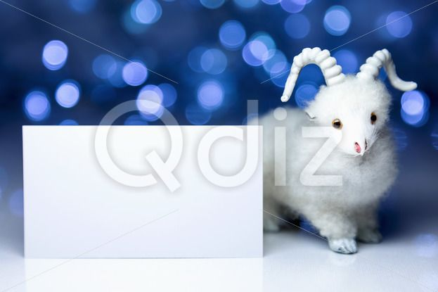 Qdiz Stock Photos | Goat or sheep with blank card,  #2015 #asia #background #blank #blur #blurred #card #celebrate #celebration #character #china #chinese #clear #closeup #concept #culture #decoration #doll #east #empty #ewe #festival #festive #figure #fun #funny #goat #greeting #holiday #japanese #jumbuck #lamb #light #little #mutton #new #religion #sheep #small #symbol #toy #tradition #traditional #white #year #zodiac