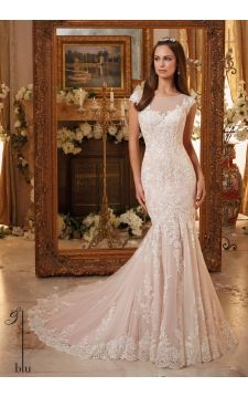 Morilee Blu collection. Style number 5466. Elegant lace cuff sleeves with naked chest design. Blush pink wedding dress. Figure hugging mermaid gown with long soft net and lace train.