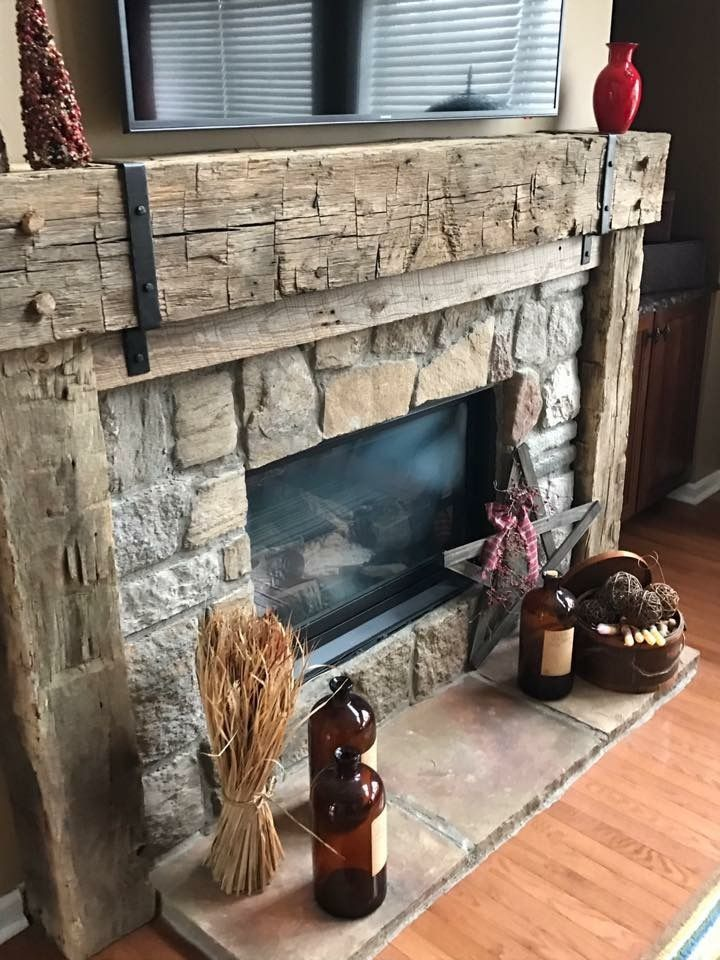 Hand hewn barn beam and straps. Fireplace mantle