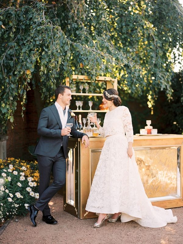 Bride and Groom Sharing a Toast with Vintage Champagne Coupes | Kristin La Voie Photography | http://heyweddinglady.com/vintage-wedding-styling-autumn-garden/