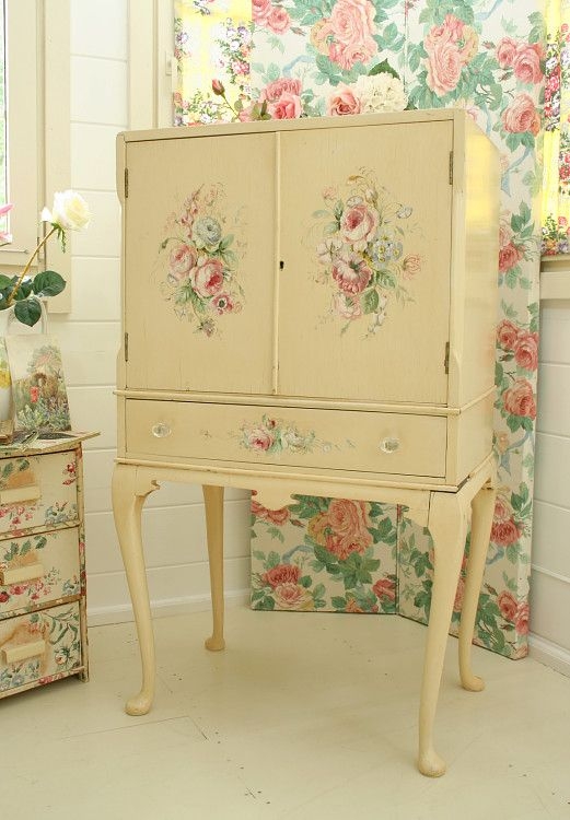 Hand Painted cabinet.. Would love this!  maybe not the flowers for use in just any room.. But I love the shape!  Would be a great file or picture cabinet... Rustic baskets or crates underneath