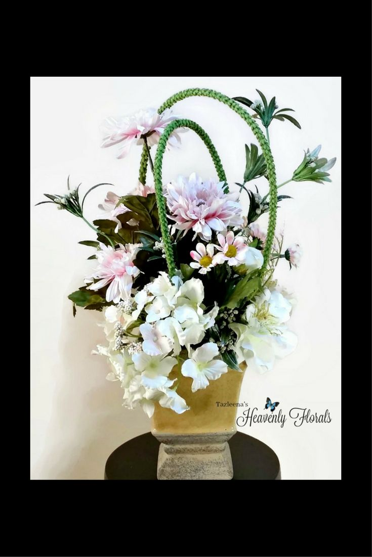 Add a soothing neutral color palette to your room with this daisy arrangement in a modern design.