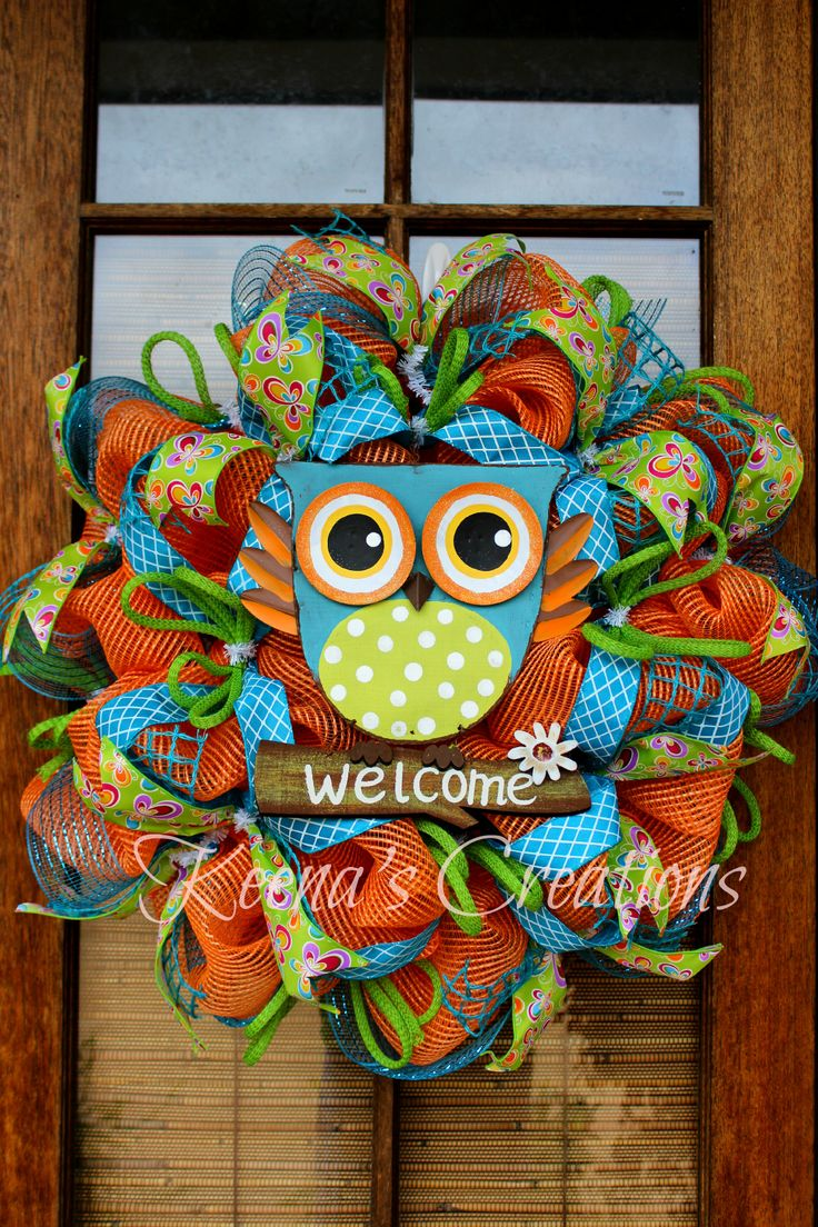 Owl Wreath Deco mesh wreath in orange, turquoise, lime and lime ribbon with butterflies and a cute owl in the center.
