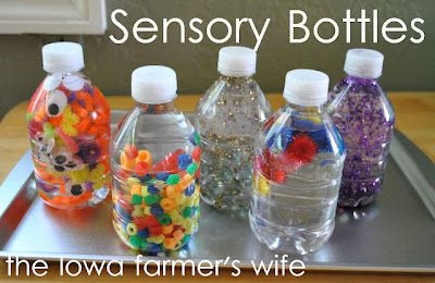 Sensory Bottles for Little Ones. I made one with googly eyes (Landon's favorite!), gems, and confetti. He loves it!