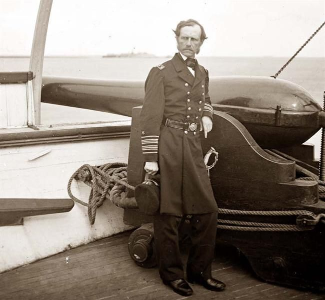 Charleston Harbor, S.C., Rear Admiral John A. Dahlgren standing by a Dahlgren gun on deck of U.S.S. Pawnee. It was taken between 1860 and 1865.  The picture shows Federal Navy, and seaborne expeditions against the Atlantic Coast of the Confederacy -- the Federal Navy, 1861-1865.