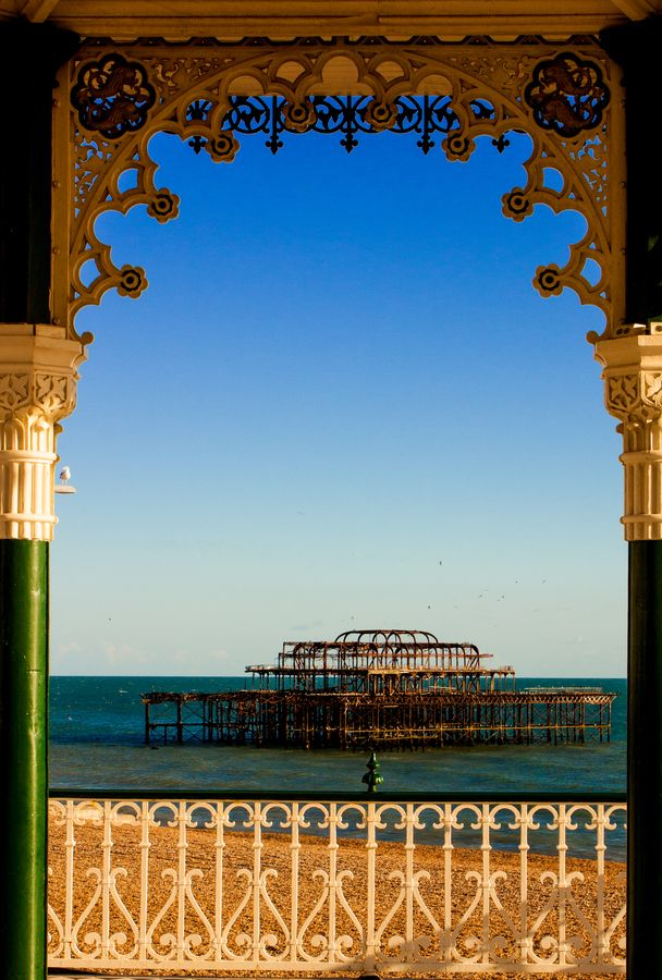 What a stunning view of Brighton's West Pier, framed beautifully by the arches.