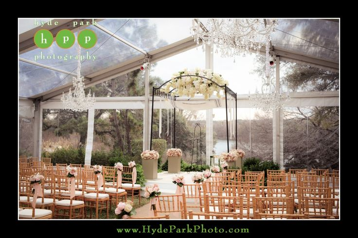 Gorgeous winter tented outdoor wedding ceremony at the Four Seasons Hotel in Downtown Austin, TX. Photo by Austin wedding photographers, Hyde Park Photography. www.HydeParkPhotography.com