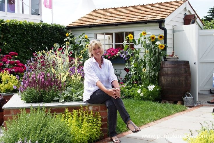 Tracy Foster in the garden she designed for the Hampton Court Palace Flower Show Garden, 'A Garden for every Retiree'.  The garden was sponsored by Just Retirement Ltd.