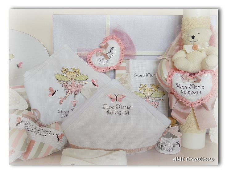 Baptism set for a sweet little girl. All the accessories have a nice cross stitch embroidery with a funny fairy and the name of the girl.