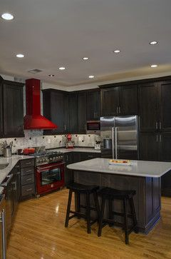 Leesburg Contemporary Kitchen - Island Seating A window in the back corner of the kitchen was removed to make room for additional countertop and storage space. The red range and hood add a pop of color. Synergy Design & Construction