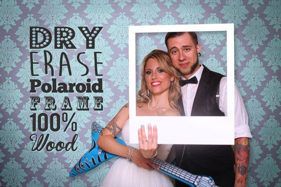 This dry erase polaroid photo booth frame will add a touch of fun to the photo booth at your wedding or party. Each Polaroid frame is made from