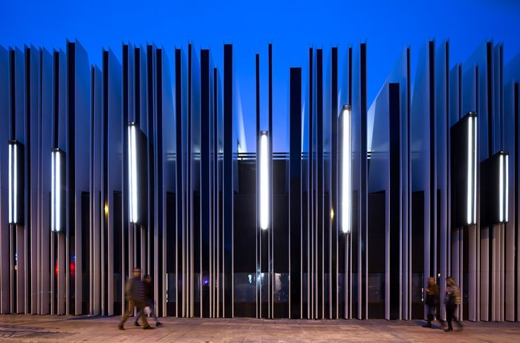 A façade with protruding lighting has been added to this building in Spain