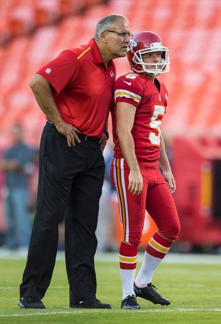 Kansas City Chiefs special teams coordinator Dave Toub, left, spoke with Kansas City Chiefs kicker Cairo Santos (5) during warmups prior to the game between the Chiefs and the New England Patriots at Arrowhead Stadium in Kansas City, Mo. on Monday night, September 29, 2014. The Chiefs are wearing their all-red uniforms.