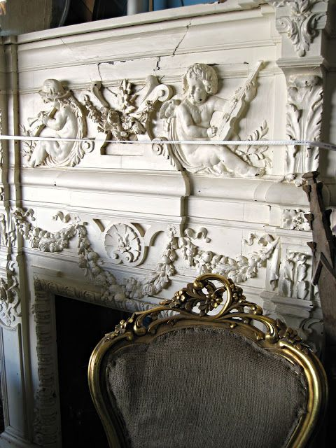 This is an antique fireplace with a great amount of decoration. For something simpler like a shell, look at www.buycarvings.com