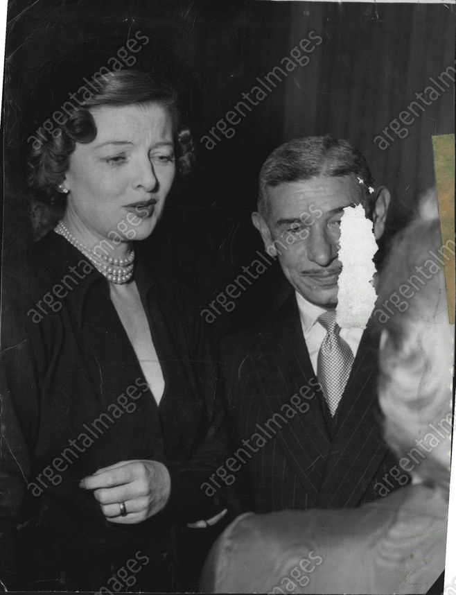 Myrna Loy and Mike Romanoff (owner of Romanoff's restaurant) at a ...