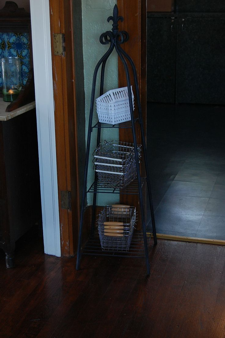 Shopping baskets are very important! I got this little plant stand at JC Penney and used it on my table for several years when I did shows. It's perfect for holding shopping baskets. You can also see the deep teal floor in the Dark Room, through the doorway.