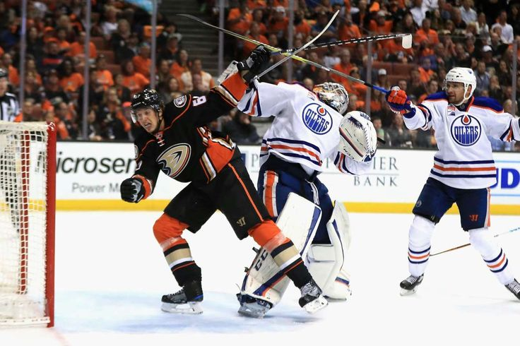 NHL playoff results, schedule  -  April 30, 2017:          Image:  Cam Talbot (33) of the Oilers collides with Rickard Rakell (67) of the Ducks on April 26 in Anaheim, California. The Oilers won 5-3.