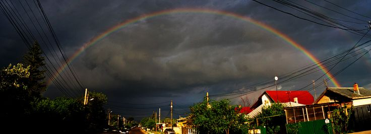 A beautiful evening rainbow, caught with a not wide enough lens. Multiple shots stitched together.