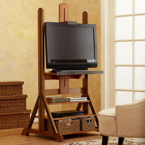 I don't like TV stands but I really like this. With casters, this would be just about perfect. Easel Media Stand | World Market