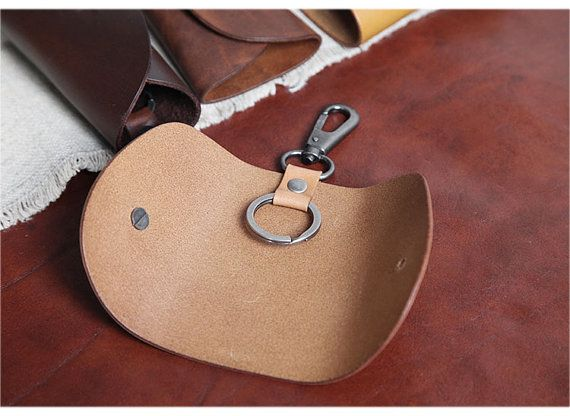 Its a 100% handmade leather key holder. Its simple but delicate. You can put many keys on it. As the key ring are no limited.  Material: Italian top layer cowhide Features:  -Key holder -Key bag -Key chian  Size: 10.8 (L) x 6.6 (W) x 3.3 (T) cm  Free to stamp logo / customizations ( English Letters and Arabic numerals are free of charge, other letters need extra 5 usd logo charges)  As the item are all handmade, please allow 5-7 days to make it. Thanks for your support!  For shipping, we…
