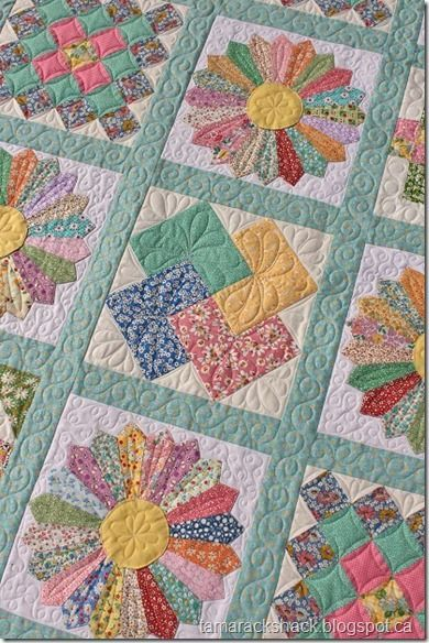 This is Linda's Dresden Plate quilt and it is made with reproduction fabrics.: